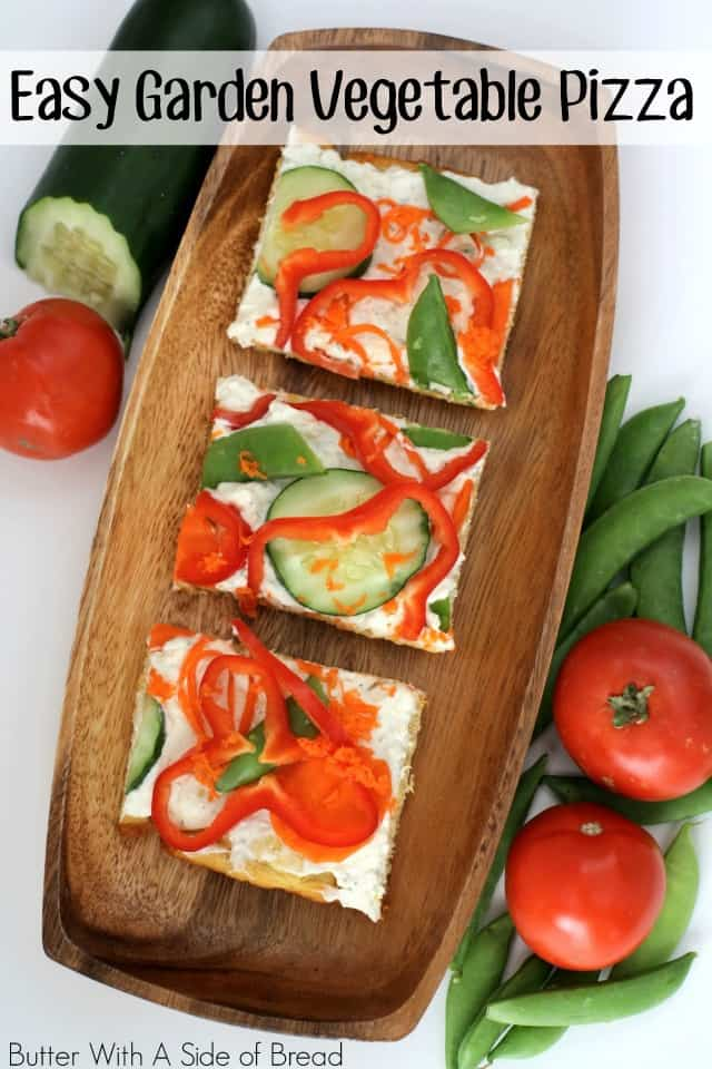 Garden Pizza has a delicious homemade pizza crust topped with fresh cut vegetables from the garden. A simple and colorful pizza that tastes great and helps you use up some of that bountiful harvest you've got growing.