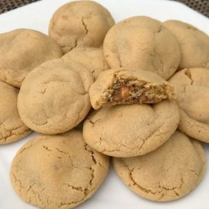Snickers Peanut Butter Cookies take an already incredible soft and delicious peanut butter cookie recipe, and add a Snickers surprise in the middle!