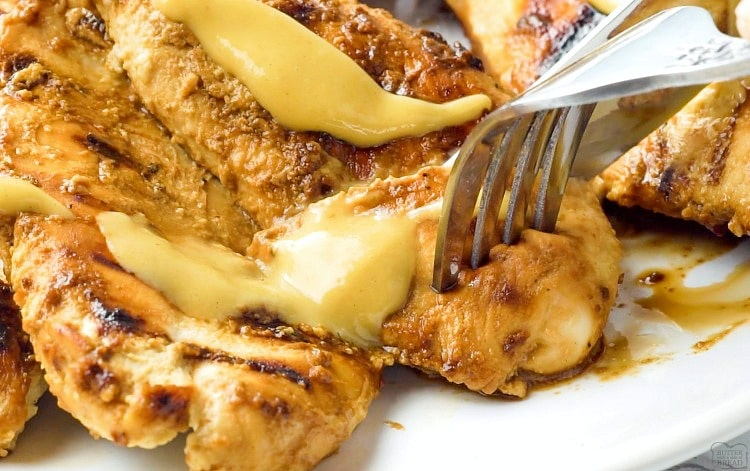 Grilled Honey Mustard Chicken recipe with a simple 4 ingredient sauce that's incredible! Yields perfectly grilled, tender, juicy chicken with amazing flavor.