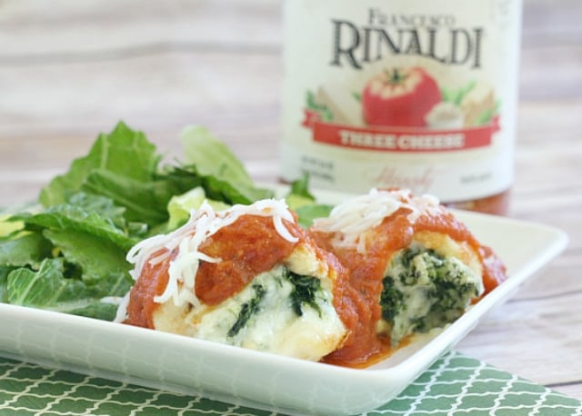 Parmesan Chicken Bundles stuffed with spinach & cheese then breaded, baked and topped with flavorful marinara sauce. Perfect Parmesan chicken dinner recipe.