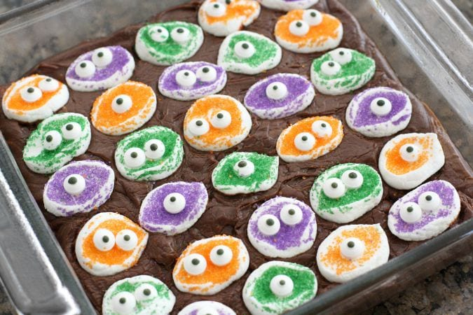 Marshmallow Monster Fudge takes a simple and delicious fudge recipe, and adds these adorable monster faces to the top to make an easy and cute Halloween treat!
