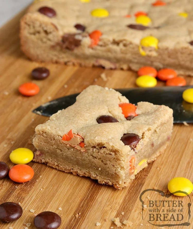 Reese's Peanut Butter Blondies are thick, soft, chewy and full of peanut butter, Reese's Pieces and Reese's Peanut Butter Cups.