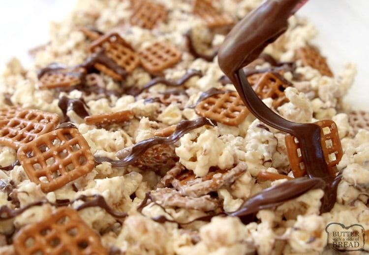 dark chocolate drizzled on popcorn