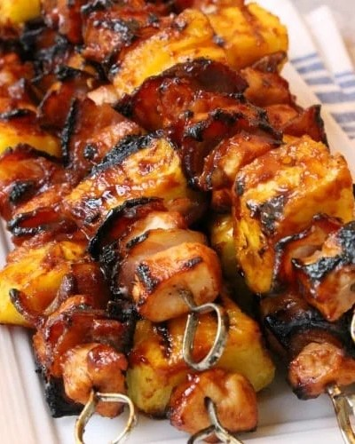 Tender chicken paired with tangy pineapple and smoky bacon all slathered with your favorite BBQ sauce. This is one of my favorite grilled BBQ chicken dinners!