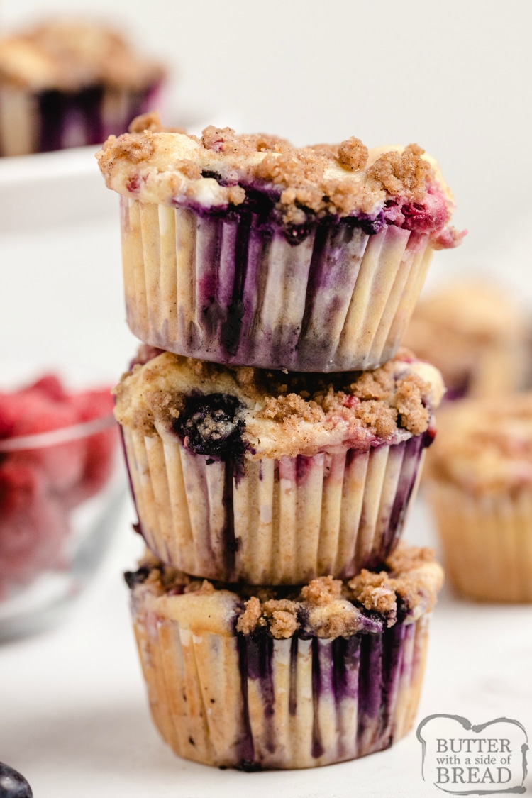 Double Berry Cheesecake Muffins are full of fresh blueberries and raspberries and have a delicious cream cheese filling in the middle! The brown sugar streusel topping adds even more flavor and a little bit of crunch!