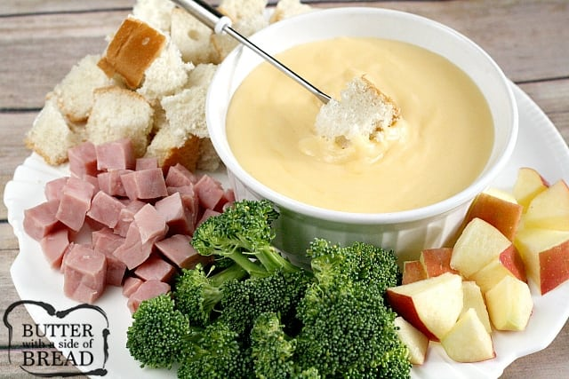 This creamy Swiss & Cheddar Cheese fondue is an easy cheese fondue recipe that is perfect for holiday dinners, parties and family gatherings!