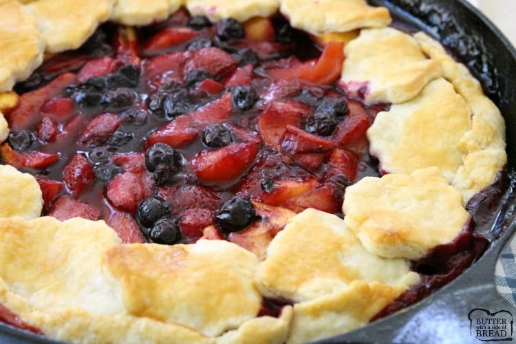 Easy Berry Peach Pie is the perfect summer pie recipe! Simple to make with an easy crust & filled with sweet fresh fruit then topped with vanilla ice cream.
