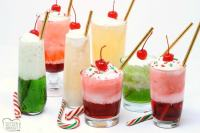Christmas Cream Sodas made with sweet syrups, cream and club soda are a delicious & festive addition to any holiday party!