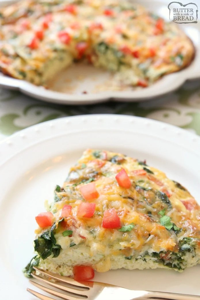 Crustless Spinach Quiche recipe that's quick & easy and tastes absolutely delicious! Packed with protein from milk, cheese and eggs, this easy quiche recipe also has spinach and fresh tomatoes. Serving crustless quiche makes prep so much easier, plus the quiche is healthier for you.