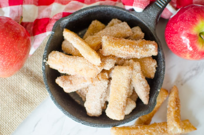 Apple Pie Fries are small strips of apple pie with a flaky crust and a simple applesauce filling. The Apple Pie Fries are fried and then tossed in cinnamon and sugar to complete this sweet, Fall time dessert.