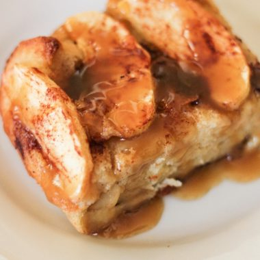 Slice of apple bread pudding with caramel sauce