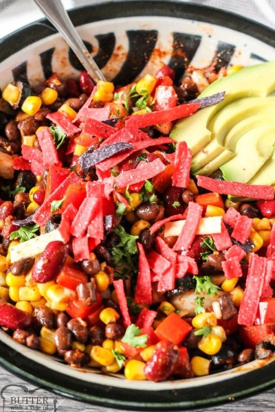 Easy Taco Salad Recipe loaded with beans, corn, peppers, onions, tomatoes and perfectly seasoned! Simple vegetarian taco salad to whip up for an easy dinner or for a potluck!
