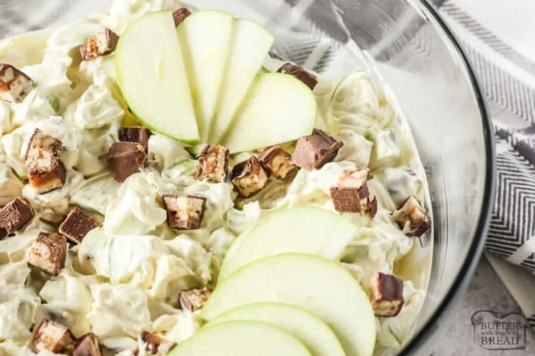 salad with snickers and apples in a glass bowl