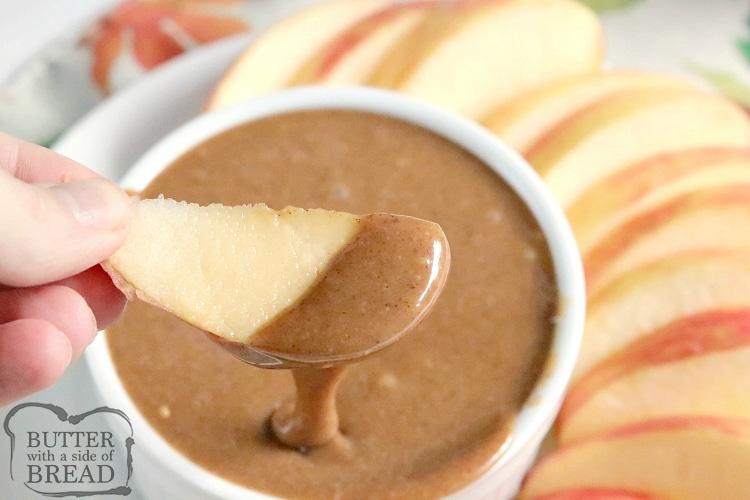Dipping apples in caramel dip