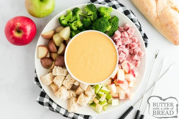 Simple cheese fondue recipe with potatoes, broccoli, apples, ham and bread