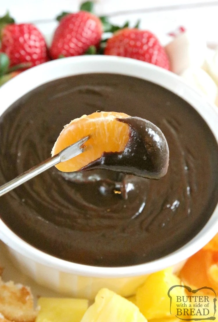 Easy Chocolate Fondue is made on the stove with only 3 ingredients and is the most delicious dessert for all occasions! This easy chocolate fondue recipe is perfect for dipping all of your favorite fruits and dippers.