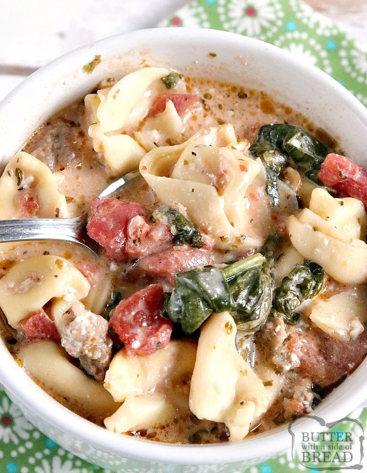 Crockpot Sausage Tortellini Soup made with Italian sausage, tortellini, fresh spinach, canned tomatoes in a flavorful creamy broth. This crockpot soup recipe only takes a few minutes of prep and then the slow cooker does the rest of the work!