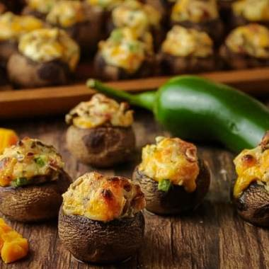 Stuffed Mushrooms are the perfect, simple appetizer. Filled with bacon, cheddar cheese, jalapeno and cream cheese, this finger food won't last long!