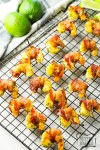 Bacon Wrapped Shrimp is a simple appetizer that only takes 6 ingredients & minutes to cook. This bacon wrapped shrimp recipe is a delicious combination of tangy lime & savory shrimp and bacon.