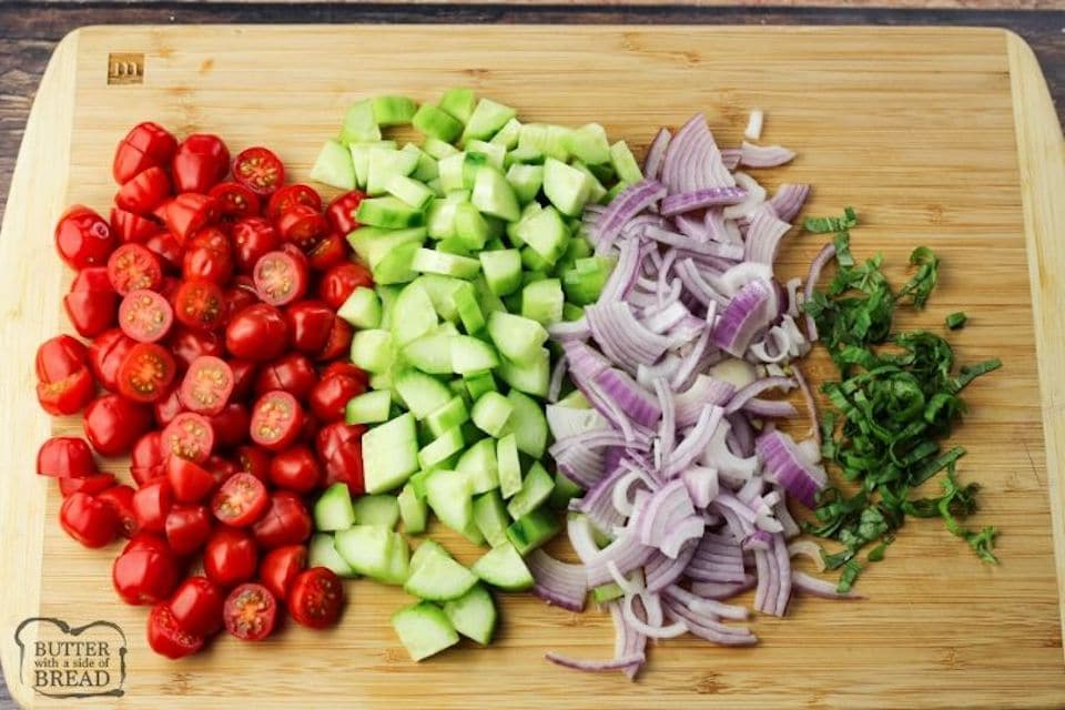 sliced vegetables on a wooden cutting board