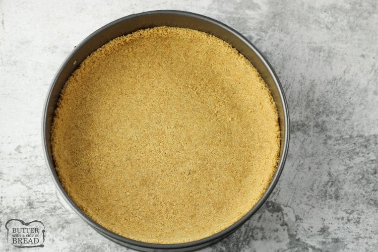 graham cracker crust in the bottom of a round pan