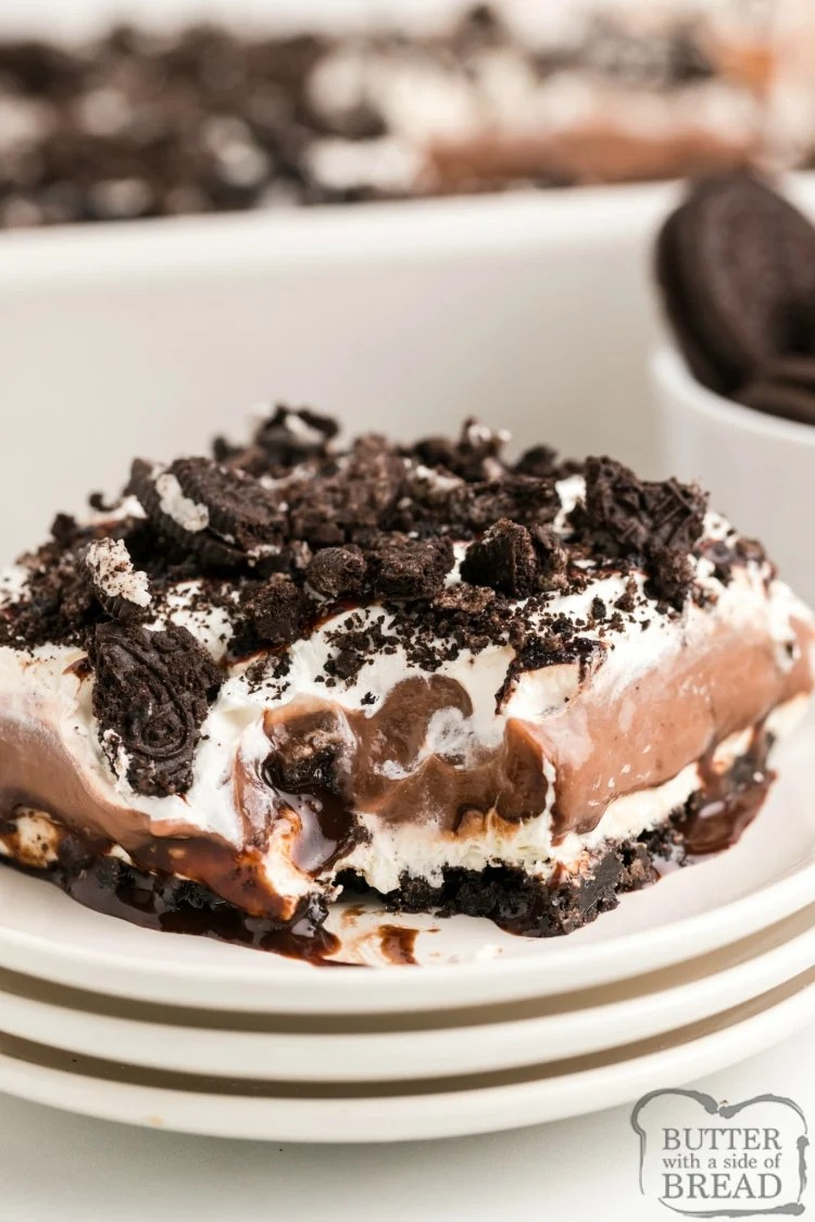 Layered Oreo Pudding Dessert is an easy dessert recipe made with Oreo cookies, cream cheese and chocolate and vanilla pudding! This dessert recipe is served cold - it's perfect for summer!
