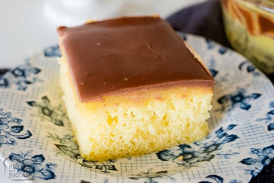 Boston Cream Pie Poke Cake is a yellow cake, poked & filled with vanilla pudding then topped with smooth chocolate ganache. This poke cake recipe mimics Boston Cream Pie, only it's more quick & easy to make!