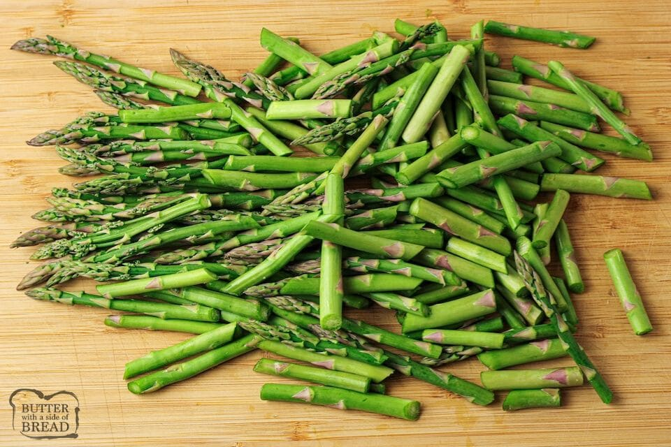 sliced asparagus on wooden cutting board