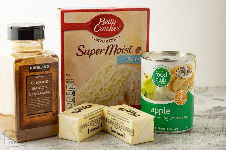 ingredients for dump cake, cinnamon, butter, apple pie filling and cake mix