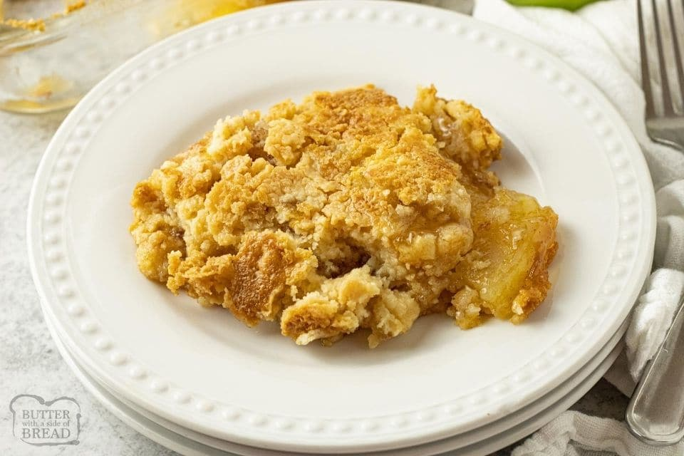 piece of apple dump cake on a white plate