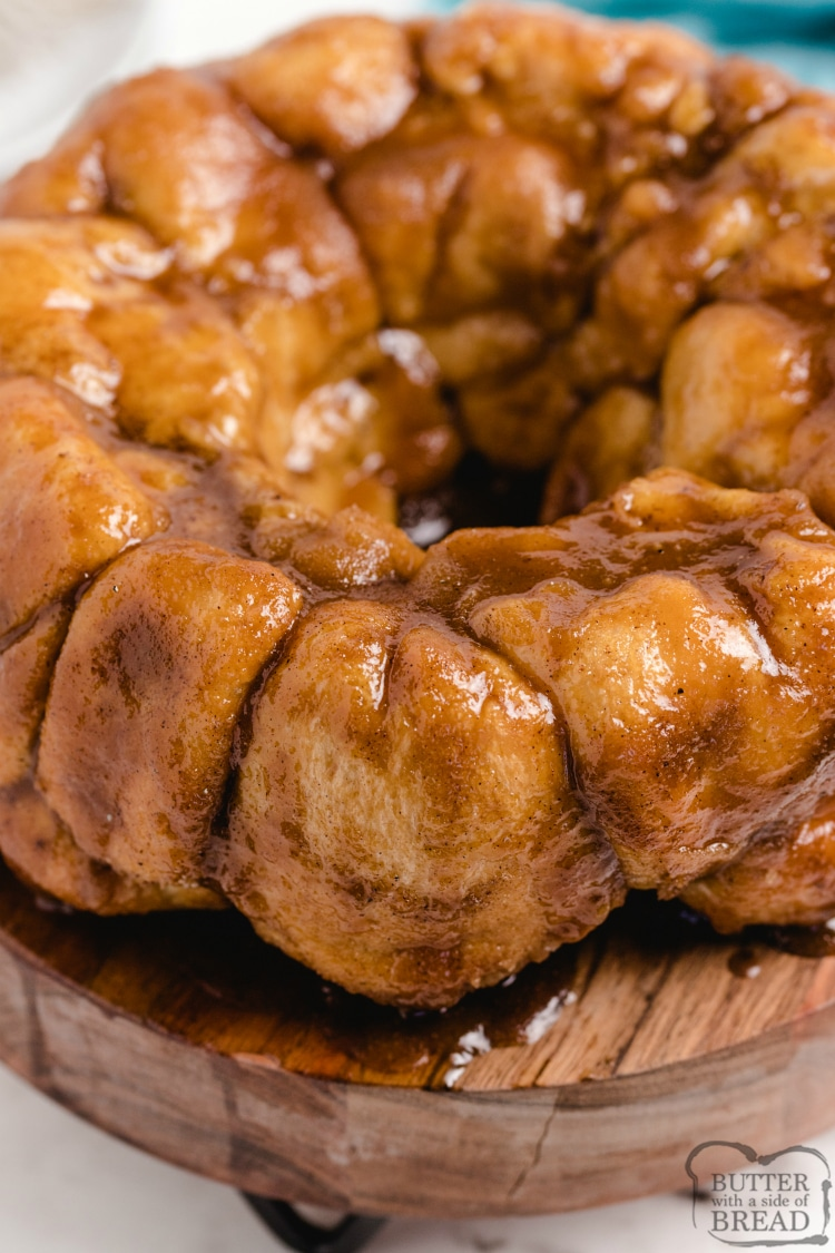 Cream Cheese Stuffed Monkey Bread are warm, gooey cinnamon rolls made with frozen rolls that are filled with cream cheese and coated in brown sugar, butter and cinnamon sugar. Only 5 ingredients to make delicious cinnamon roll monkey bread!