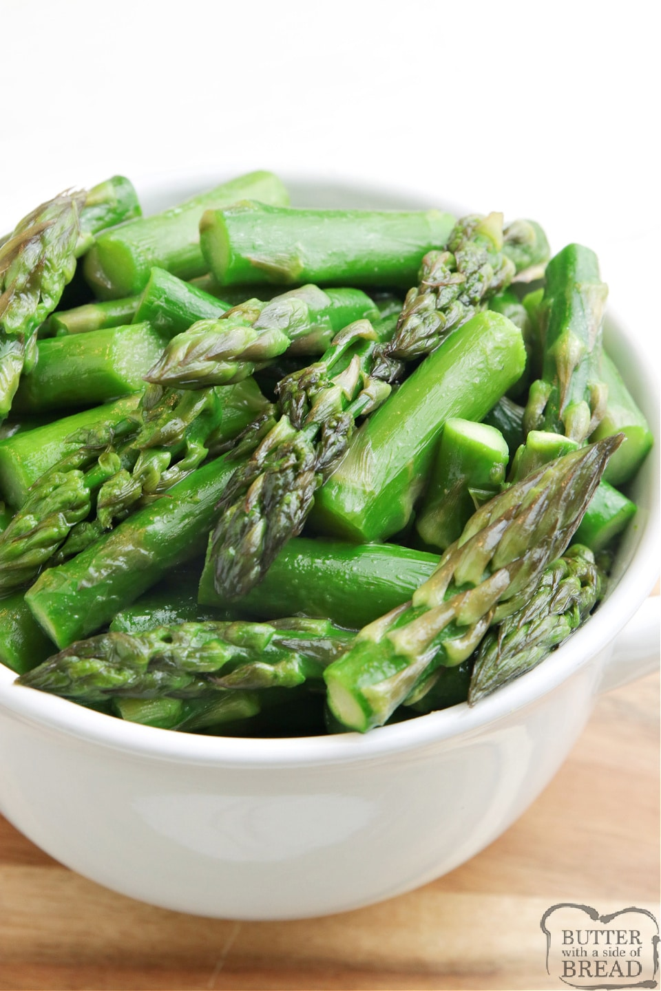 Sugared Asparagus recipe made with brown sugar, butter and chicken broth. Perfect balance of sweet and savory for a simple asparagus recipe that is made on the stove in just a few minutes.