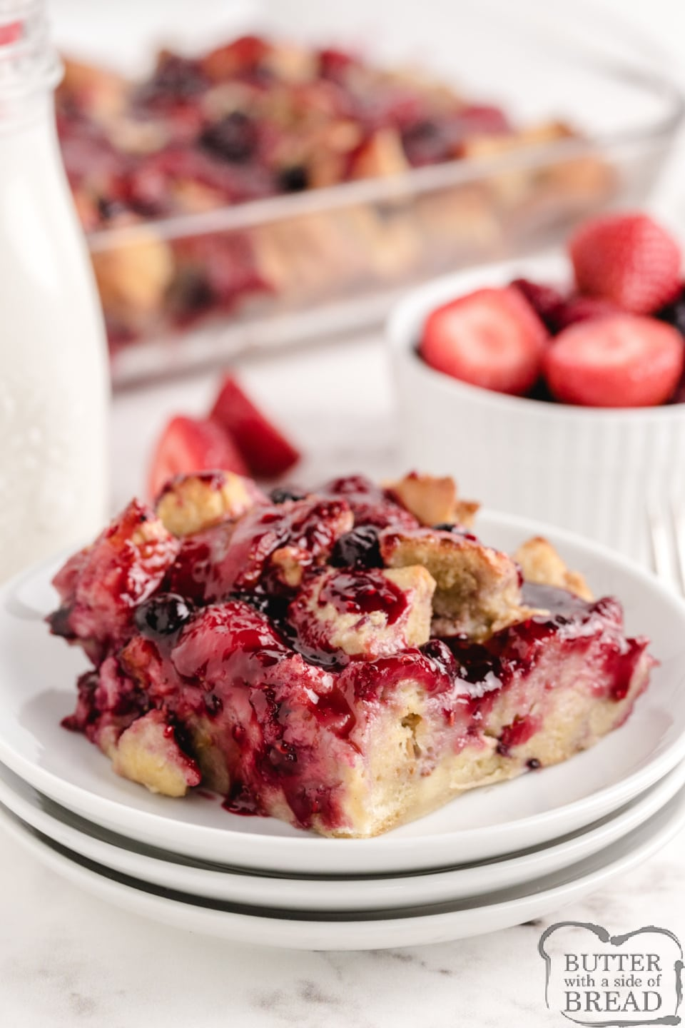 Berry French Toast Bake is made with french bread, eggs, cream, fresh strawberries and frozen mixed berries. This baked french toast recipe is simple, delicious and perfect for breakfast or dinner!