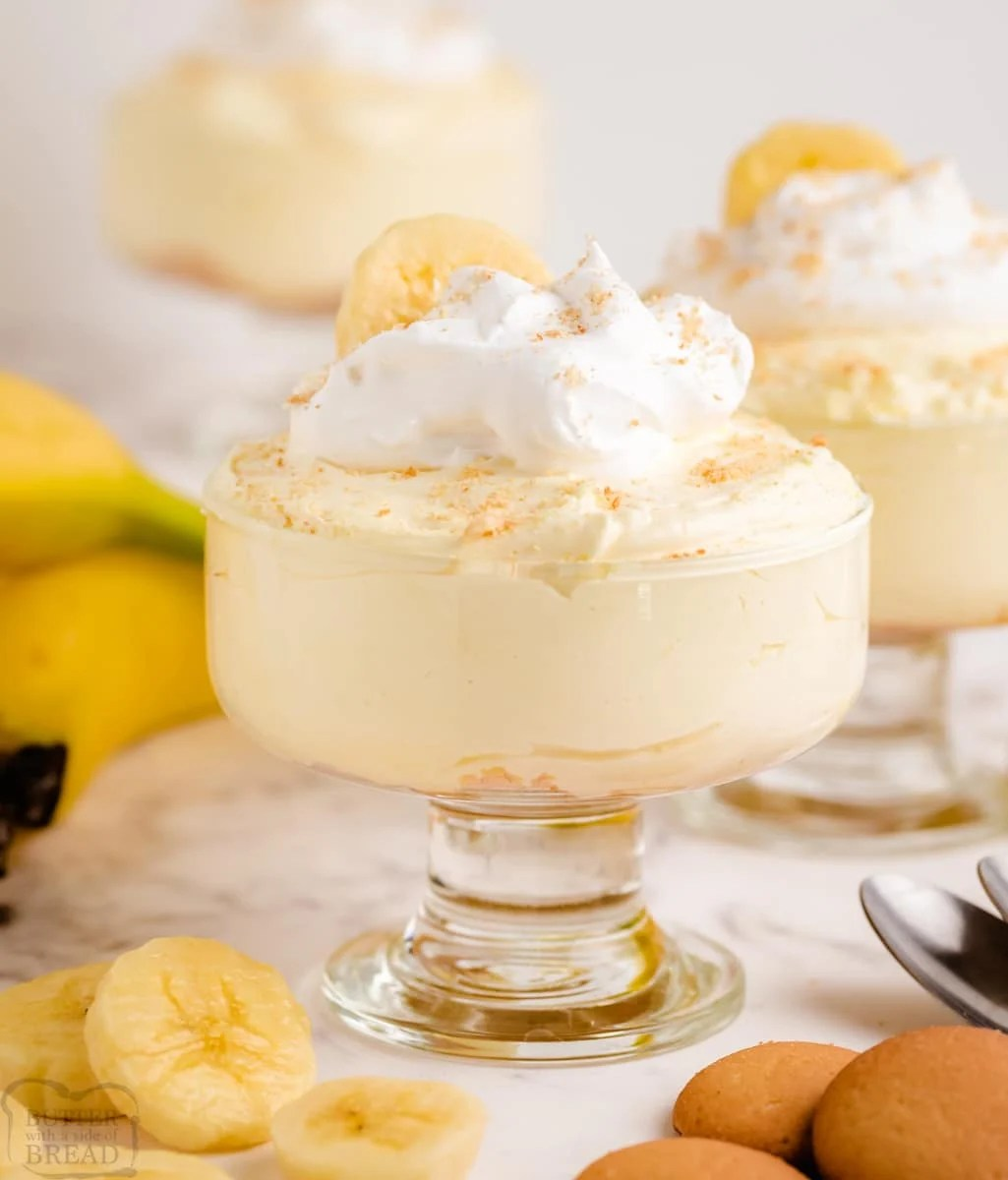 banana cheesecake in a small glass bowl with sliced bananas
