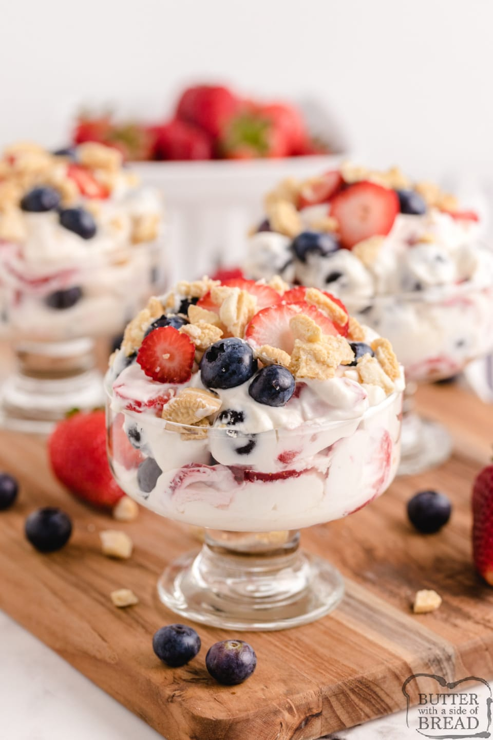 Lemon Berry Yogurt Parfaits made with sweetened whipped cream, yogurt and lots of fresh berries. Simple no-bake dessert or snack that is light and delicious!