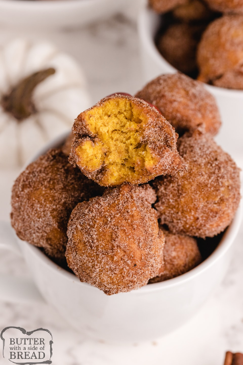 Pumpkin Donut Holes are soft, delicious and easy to make - no yeast necessary! Coated in cinnamon and sugar, and packed with pumpkin, this donut hole recipe is perfect for fall!