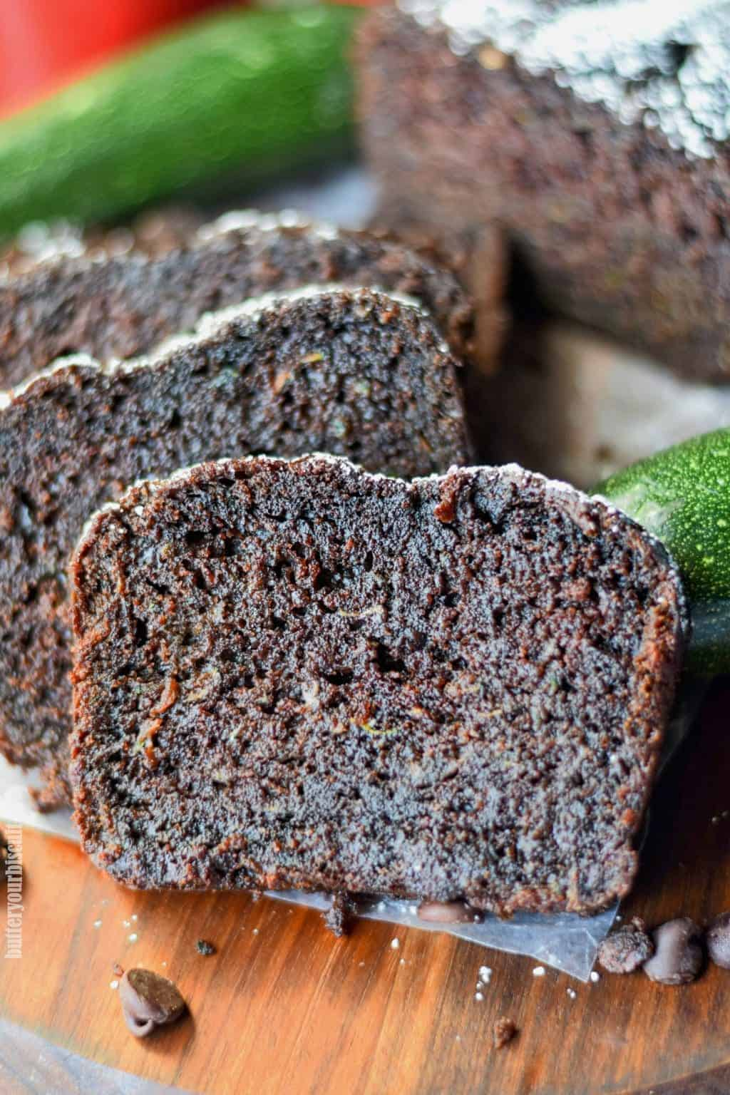 chocolate zucchini bread stacked on a cutting board