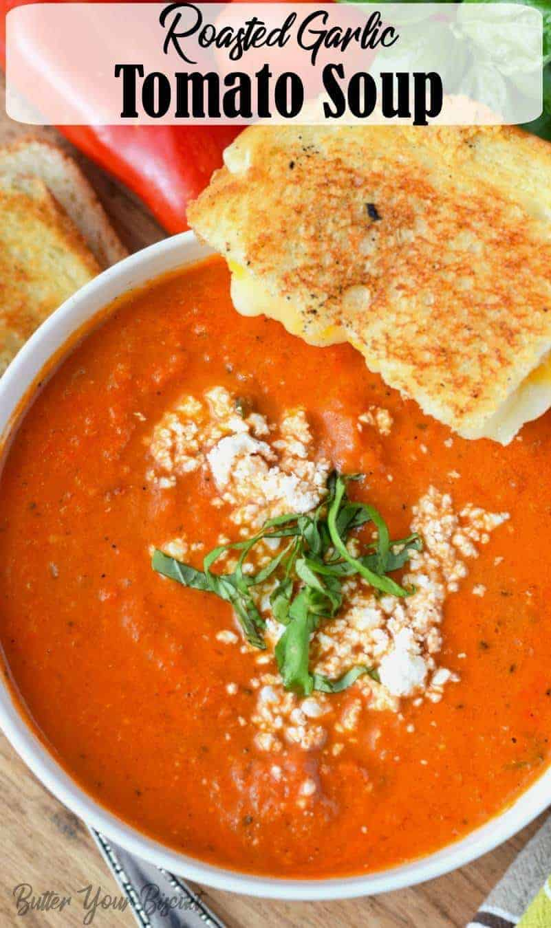 Roasted Tomato Garlic Soup is smooth and creamy with incredible flavors. Served with a warm grilled cheese, makes this the perfect comfort food. #tomatosoup #roastedgarlictomatosoup #comfortfood #homemadesoup