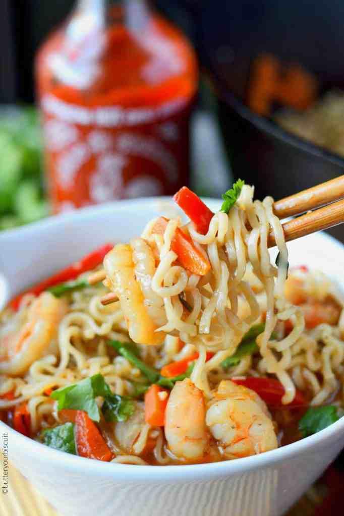 Spicy shrimp ramen bowl on chopsticks