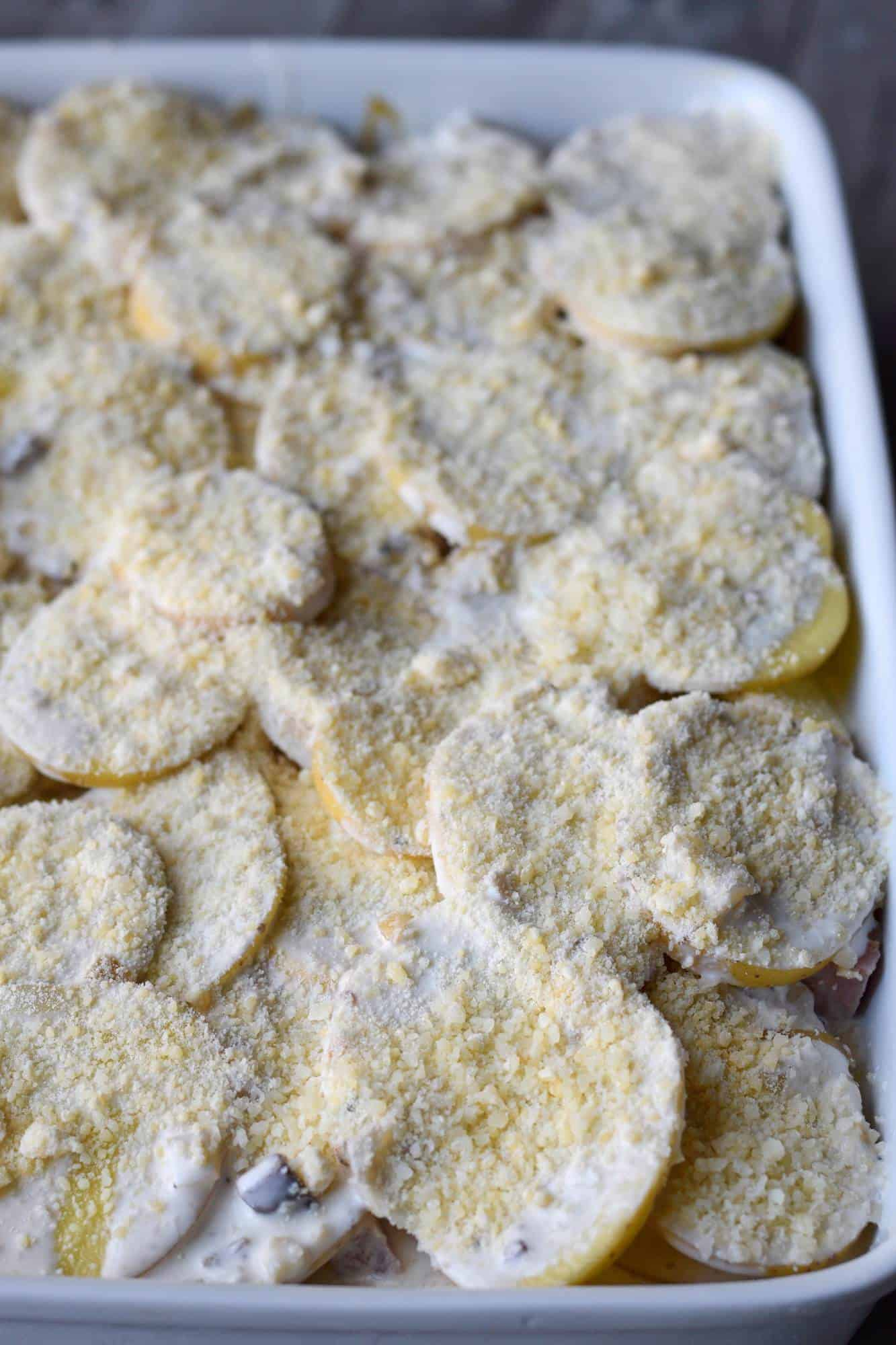 Parmesan Scalloped potatoes and ham before baking