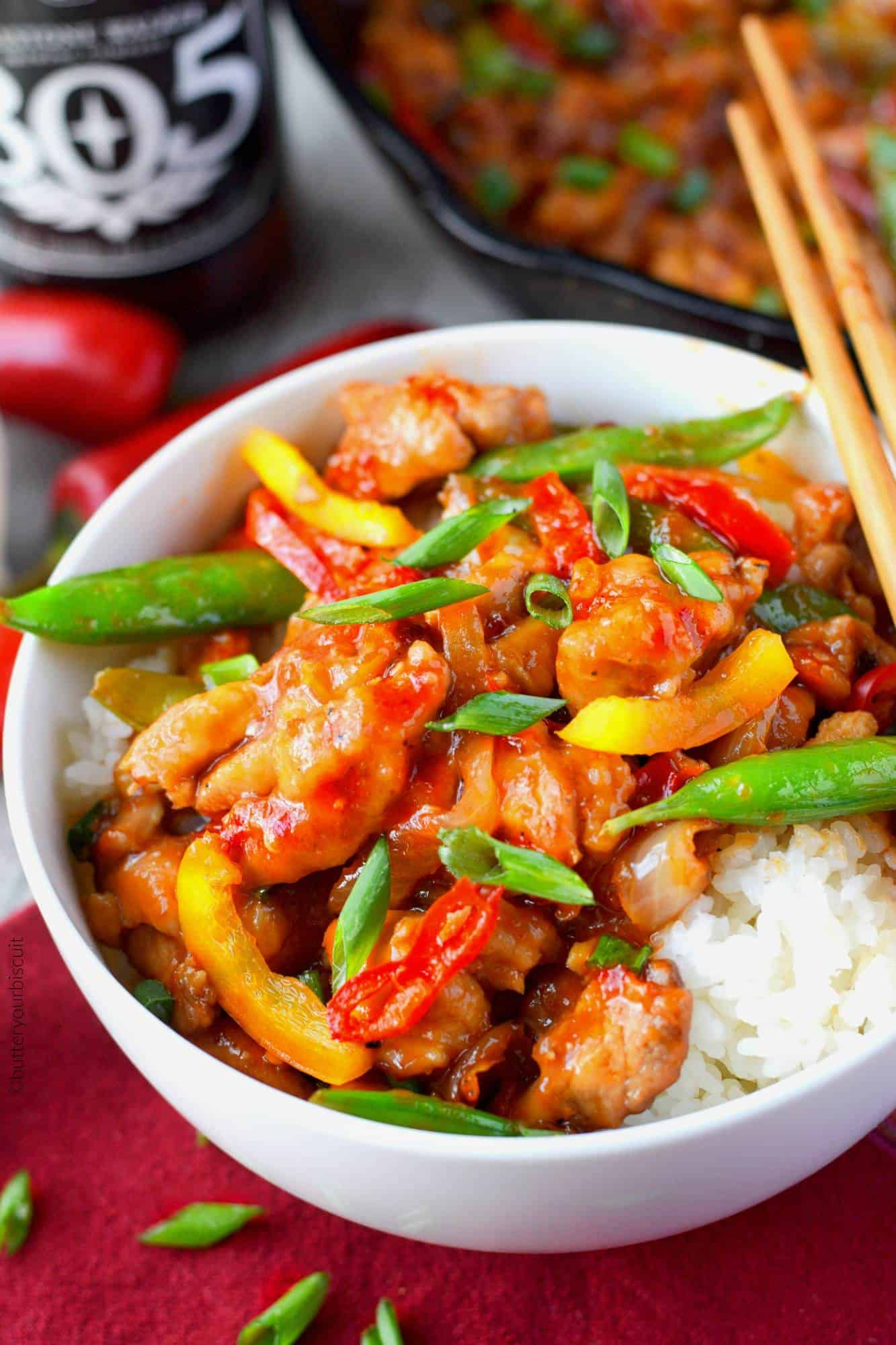 Sweet and Spicy chicken stir fry in a white bowl