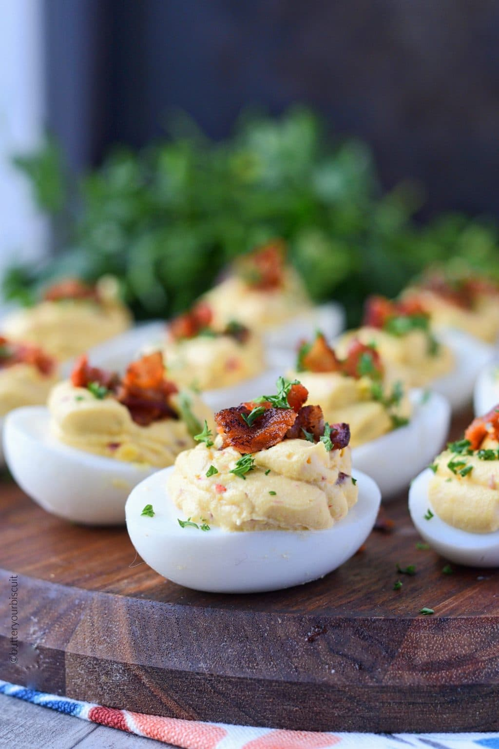 Chipotle bacon deviled eggs served on a small cutting board