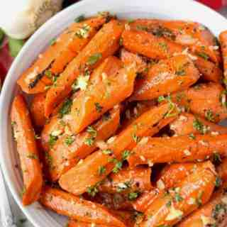honey garlic roasted carrots in a white bowl