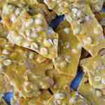 Microwave peanut brittle piled on a baking sheet