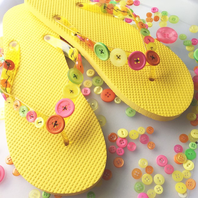yellow flip flops with buttons