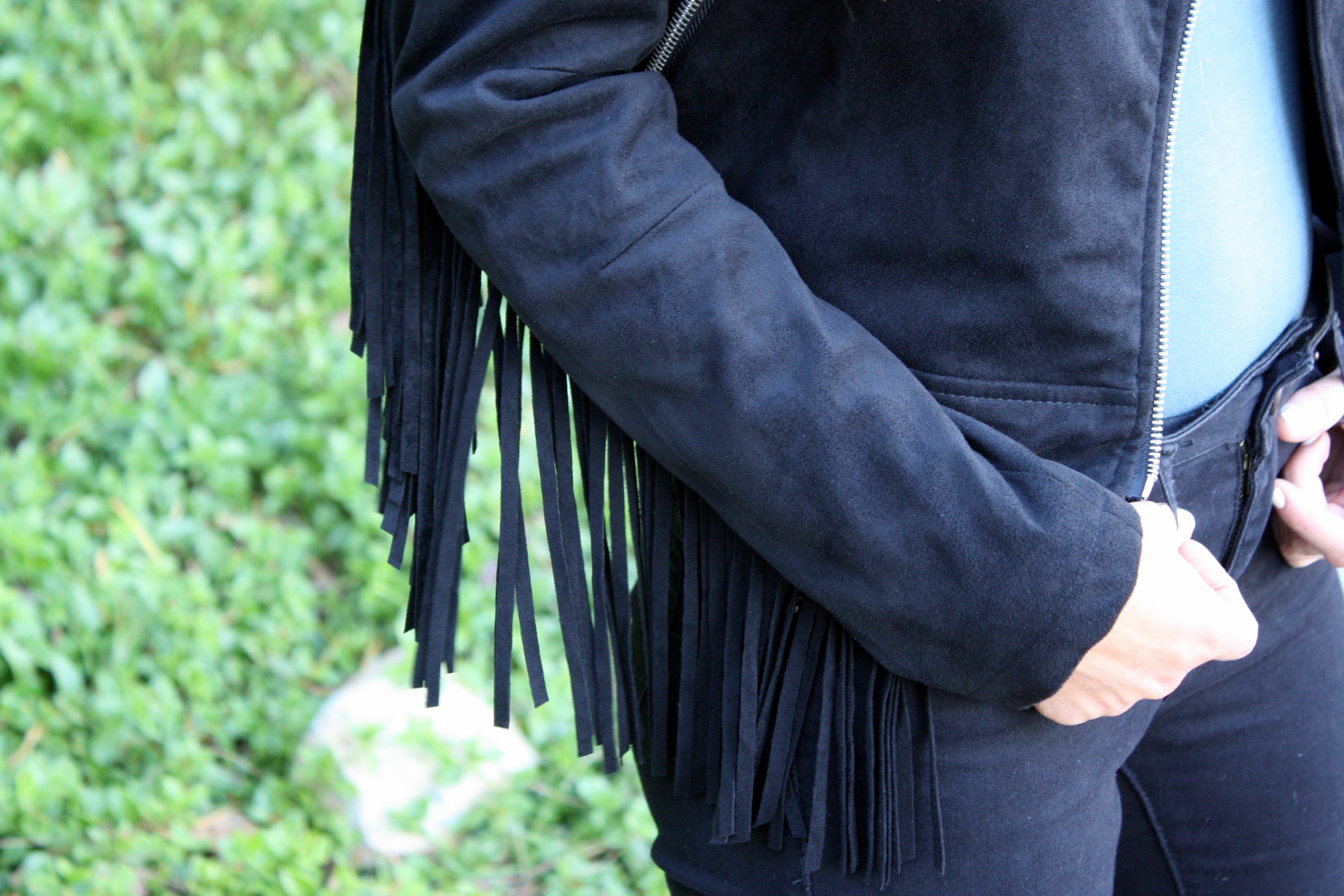 black fringe jacket and high waisted pants for fall