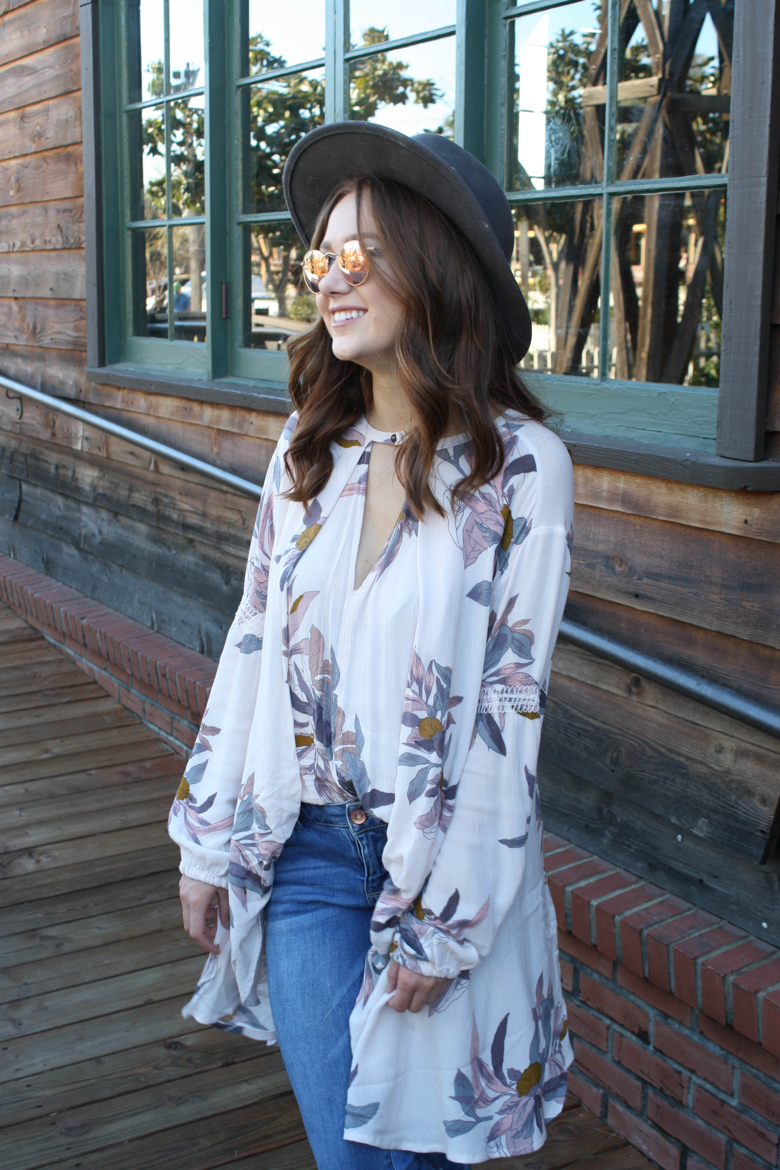 Transitioning to spring fashion with Allison Kelley's favorite floral tops and dresses from free people
