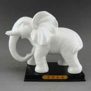 Beautifully crafted with special attention given to details, this absolutely stunning Pair of Elephants in ivory white and with the Chinese characters 吉祥如意
