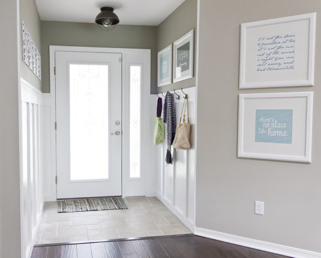 This color is GORGEOUS! (and you can get it at Lowe's or Bralys! The color is Valspar's Magic Spell) What an inviting entryway by Jenna Sue.