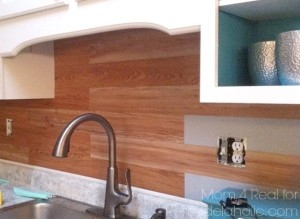 A great tutorial on using peel and stick vinyl tiles as a backsplash from Mom 4 Real.  If you don't like the wood look, that's ok, just find a peel n stick design you do like! Easy peasy!